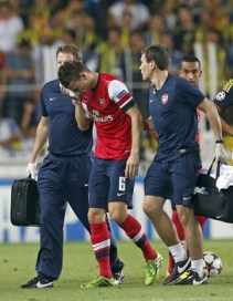 Arsenal's Koscielny walks out of the pitch after an injury during their Champions League qualifying soccer match against Fenerbahce in Istanbul